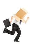 Man with a cardboard box on his head running away Royalty Free Stock Photo