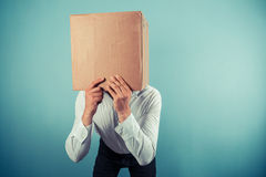Man with cardboard box on his head Stock Photography