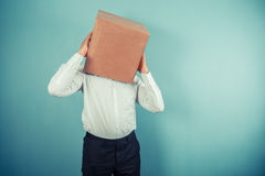 Man with cardboard box on his head Royalty Free Stock Image