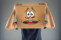 Man with cardboard box on his head and terrified look skethed Royalty Free Stock Photography