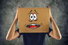 Man with cardboard box on his head and terrified look skethed Royalty Free Stock Images
