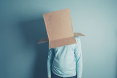 Man with a cardboard box over his head Royalty Free Stock Photography