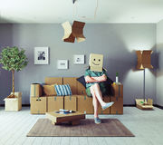 Man in cardboard boxes design room Stock Photography