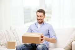 Man with cardboard boxes at home Stock Images