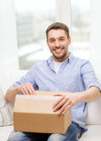 Man with cardboard boxes at home Royalty Free Stock Images