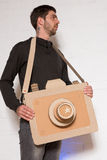 A man with a cardboard camera. Cheerful man with a handmade cardboard camera Royalty Free Stock Photography