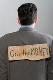 Man with cardboard sign Give the money Royalty Free Stock Image