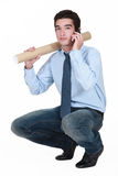 Man with a cardboard tube Royalty Free Stock Image