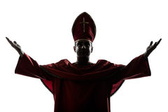 Man cardinal bishop silhouette saluting blessing. One man cardinal bishop silhouette saluting blessing in studio isolated on white background Royalty Free Stock Images
