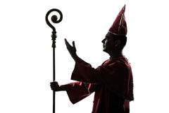 Man cardinal bishop silhouette saluting blessing Royalty Free Stock Photos