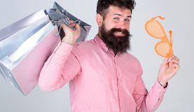 Man carefree bearded hold shopping bags. Shopping dumb wasting money. Stupid things you do with your money. How to stop. Buying things you dont need. Obsessed stock photos