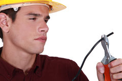 Man carefully cutting wire Royalty Free Stock Photography