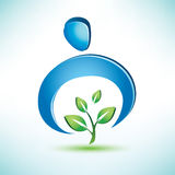 Man cares about a green tree. Conceptual symbol Royalty Free Stock Photo