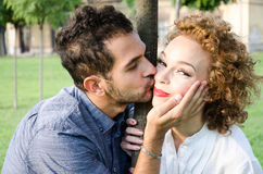 Man caressing a woman in the face Stock Photos