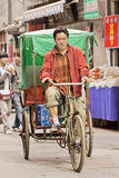 Man on cargo bike in a narrow alley, Xian, China Royalty Free Stock Photo