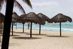 Man on Caribbean beach with umbrellas, Playa del Carmen, Mexico Stock Image