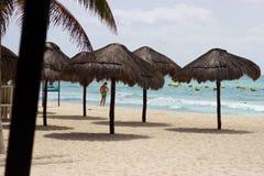 Man on Caribbean beach with umbrellas, Playa del Carmen, Mexico Stock Image