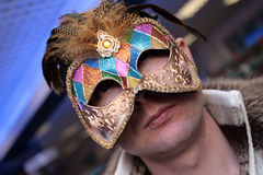 Man in the carnival mask. The man poses in the carnival mask Stock Image