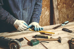 Man carpenter in his home manufactory Stock Image