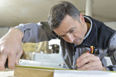 Man at carpentry work Stock Photos