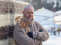 Man and carpet beater Stock Photography