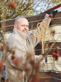 Man and carpet beater Royalty Free Stock Photography