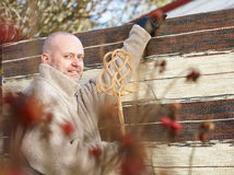 Man and carpet beater Stock Photo