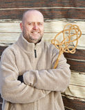 Man and carpet beater Stock Image