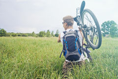 Man carries bicycle Stock Images