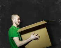 A man carries a box on the background Board Stock Photo