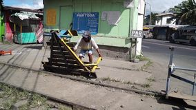 Man carries foot driven passenger trolley cart across the highway. San Pablo City, Laguna, Philippines - November 5, 2012: Man carries foot driven passenger stock video