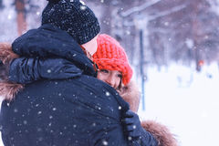 Man carries a girl young couple in winter Royalty Free Stock Photography
