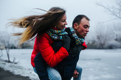 Man carries his girlfriend on back Royalty Free Stock Photos