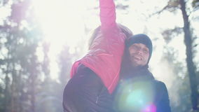 Man carries his girlfriend on his back . Winter stock video