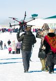 Man carries on his shoulder a large drone stock image