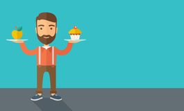 Man carries with his two hands cupcake and apple Royalty Free Stock Photo
