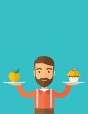 Man carries with his two hands cupcake and apple Stock Image