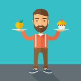 Man carries with his two hands cupcake and apple Stock Photography