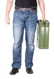 Man carries jerrycan Royalty Free Stock Photography