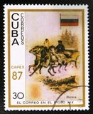 Man carries the load on a cart with three horses, Russia flag, the mail in the 19 century, circa 1987. MOSCOW, RUSSIA - JULY 15, 2017: A stamp printed in Cuba royalty free stock images