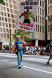 Man Carries Sign Urging Sinners To Repent At Atlanta Parade. Atlanta, GA, USA - August 31, 2013:  A man carrying a sign showing the incredible hulk, urges Royalty Free Stock Images