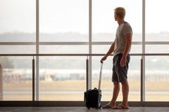 Man carries your luggage at the airport terminal Stock Images
