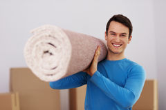 Man carring a carpet Stock Photography