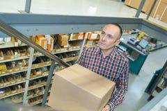 Man carring carton box in store Royalty Free Stock Photos