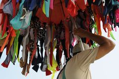 Man carring the swimming suits to sell them. stock photo