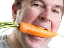 Man with carrot Stock Images