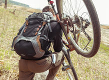 Man carry bicycle Stock Photo