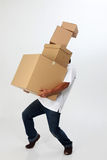 Man carry boxes Stock Images