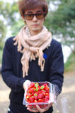 A man carry strawberry. A man carry fresh red strawberry in box Royalty Free Stock Photography