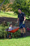 Man carry his daughter in a wheelbarrow Royalty Free Stock Images